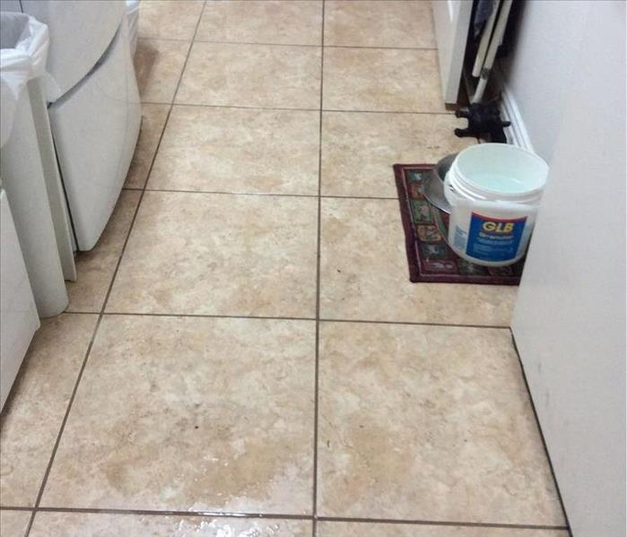 Water Damaged Laundry room in McKinney,TX Before