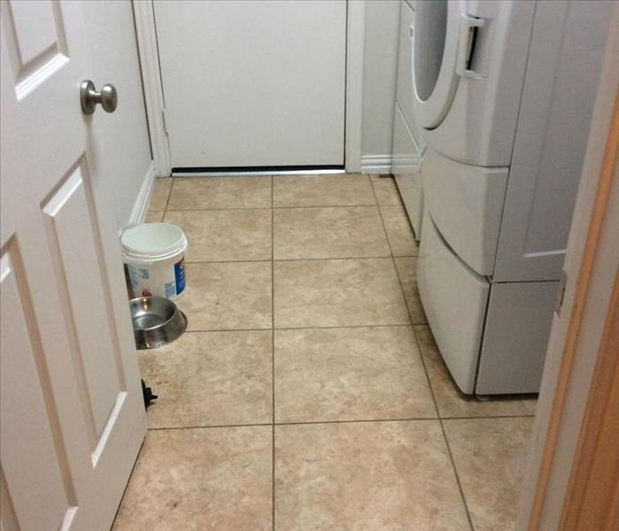 Water Damaged Laundry room in McKinney,TX After