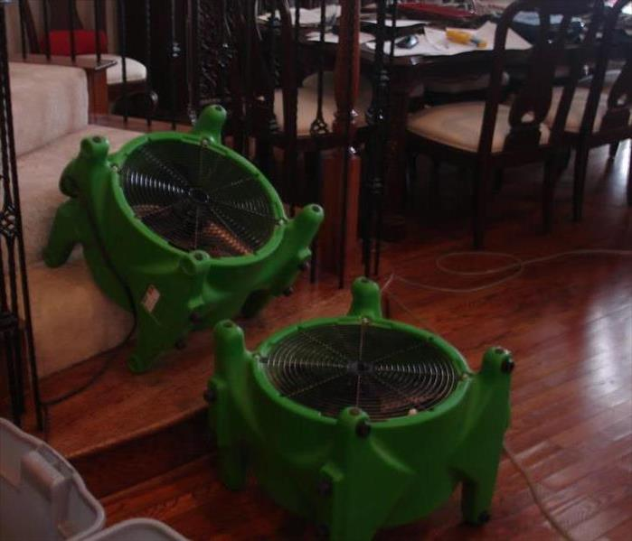 Equipment axial fans isolating air to water damaged wood floors