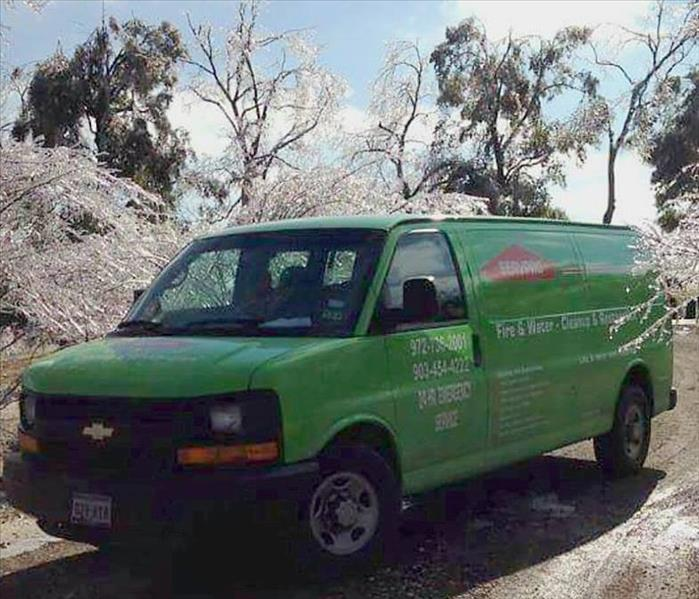 SERVPRO van in front of frozen trees with ice on road