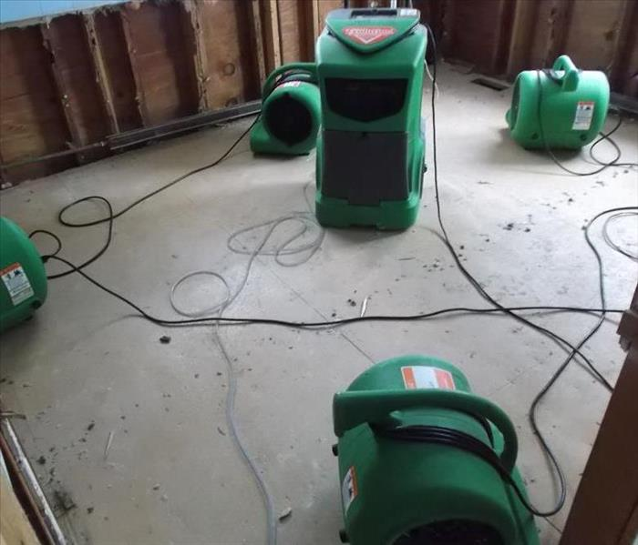 air movers and equipment being used to dry water damage