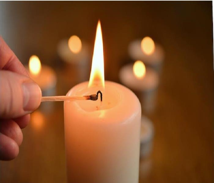 Candle being lit with match