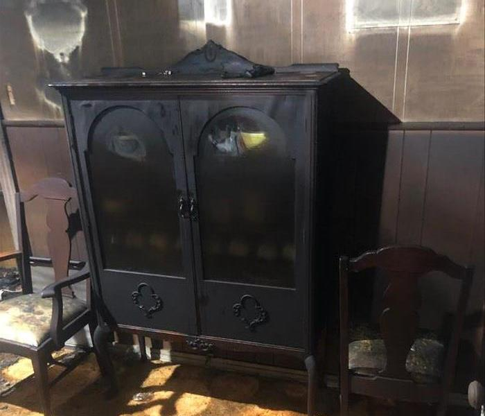 Antique furniture piece with severe smoke damage